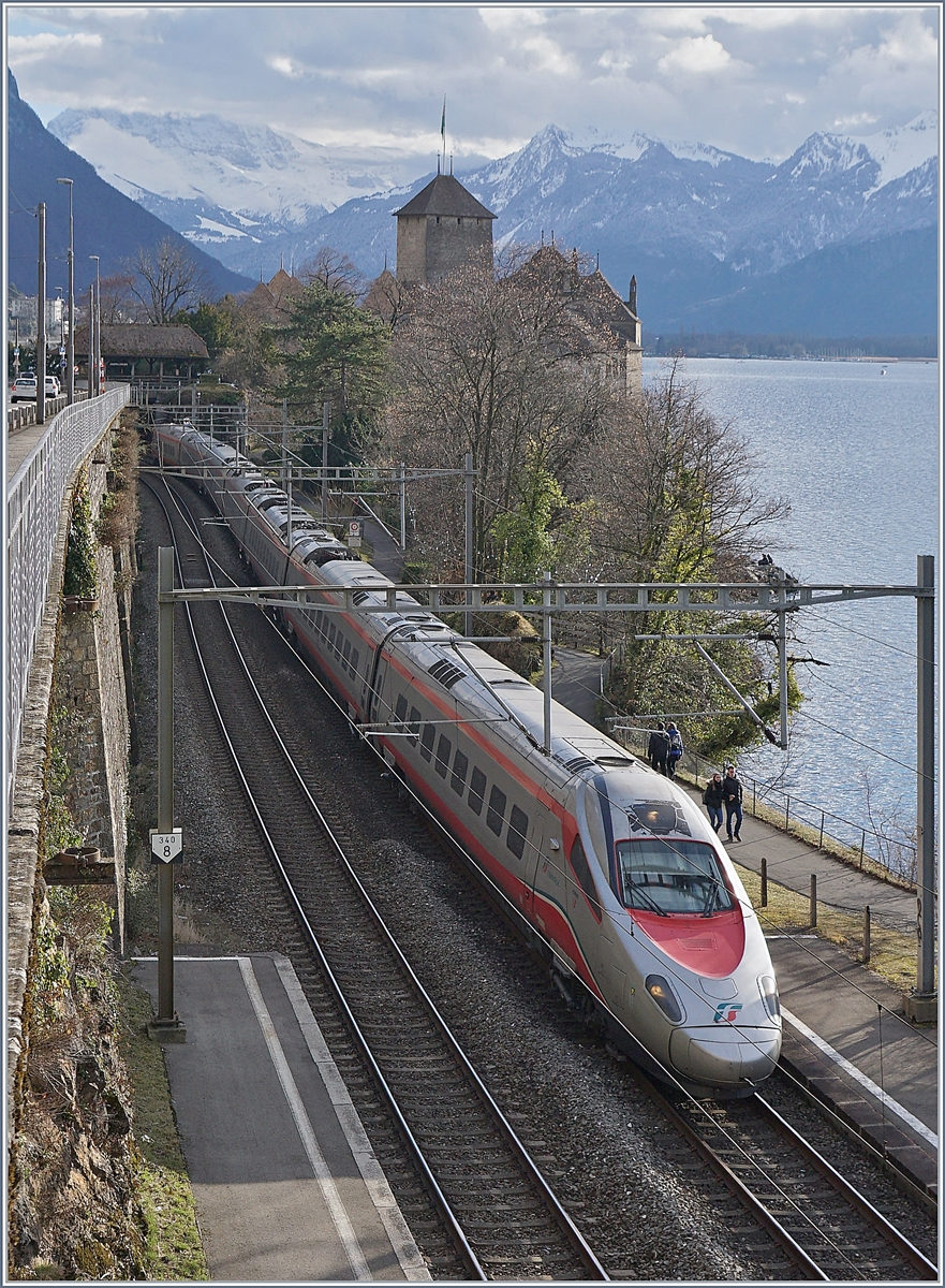 A FS Trenitalia ETR 610 on the way to Geneva by the Castle of Chillon.