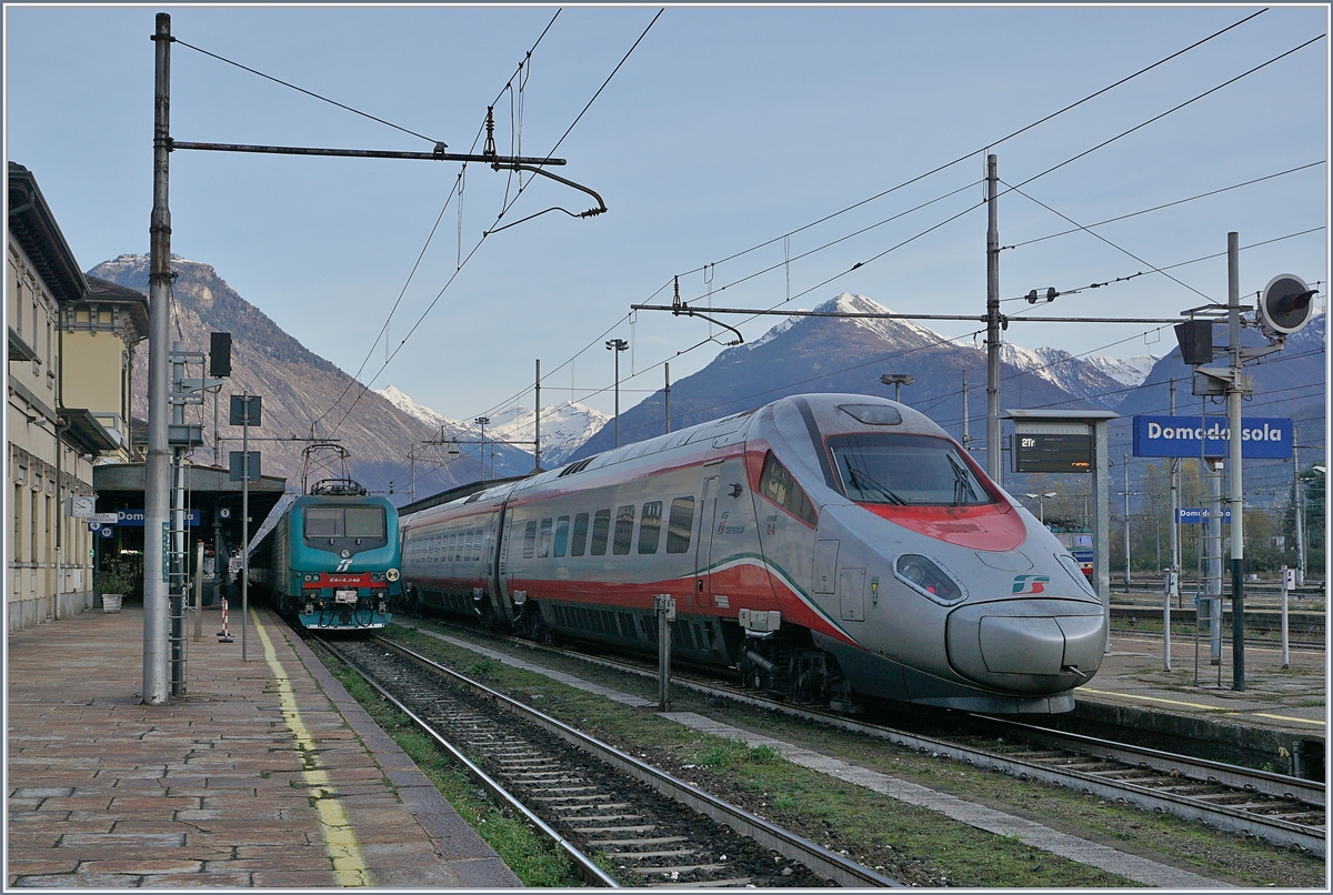 A FS TRenitalia ETR 610 is arriving at Domodssola.
