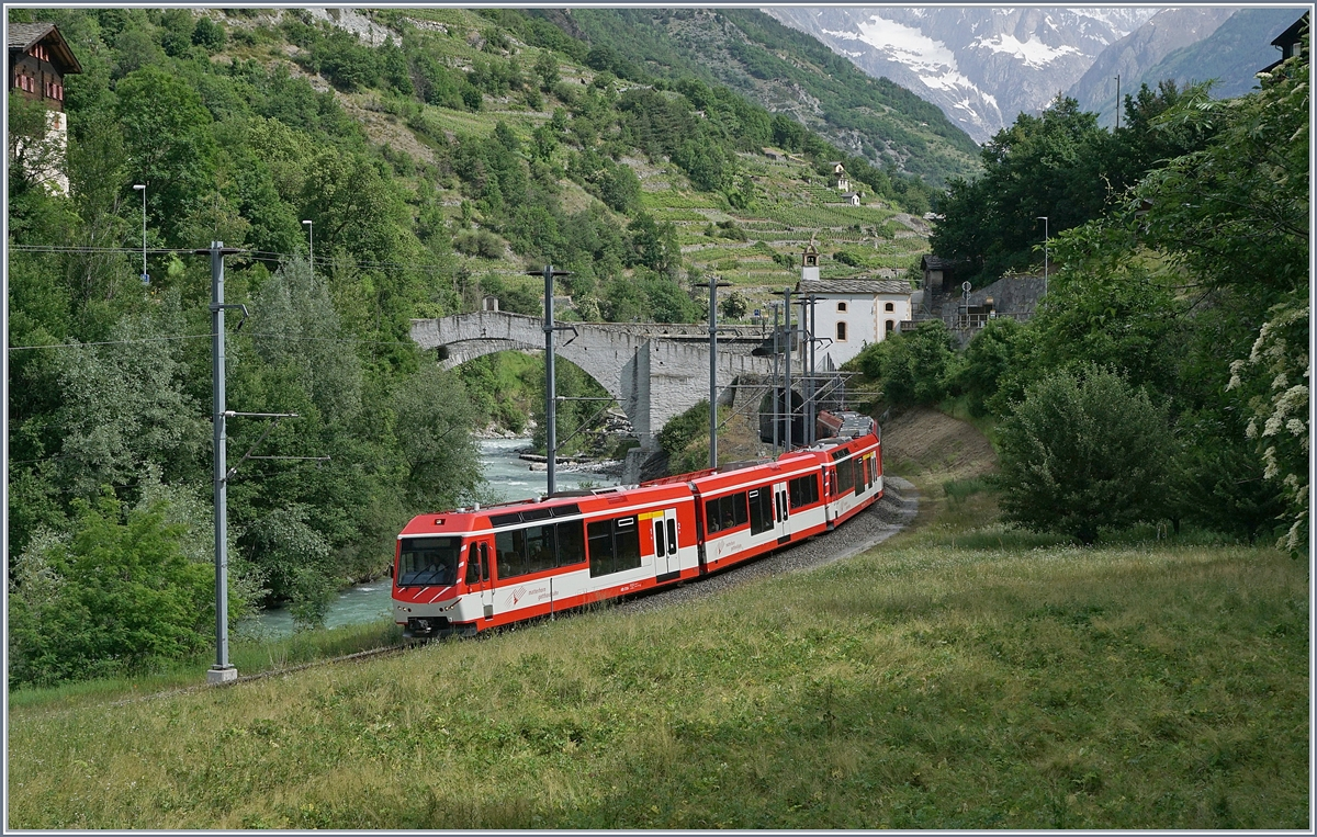A MGB local train on the way to Zermatt by Neubrück. 