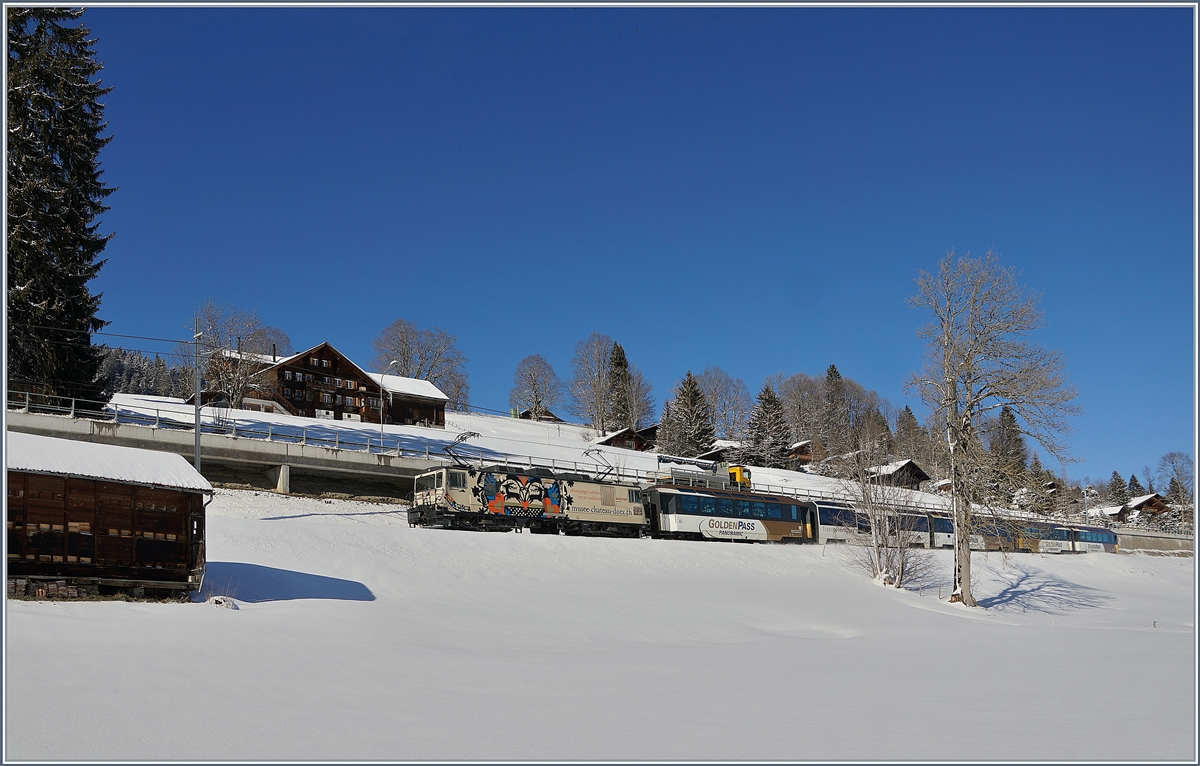 A MOB GDe 4/4 with a MOB Panoramic Express by Schönried.