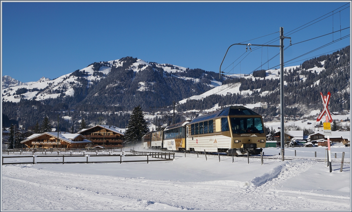A MOB GoldenPass Panoramic Express on the way to Zweisimmen by Gstaad. 