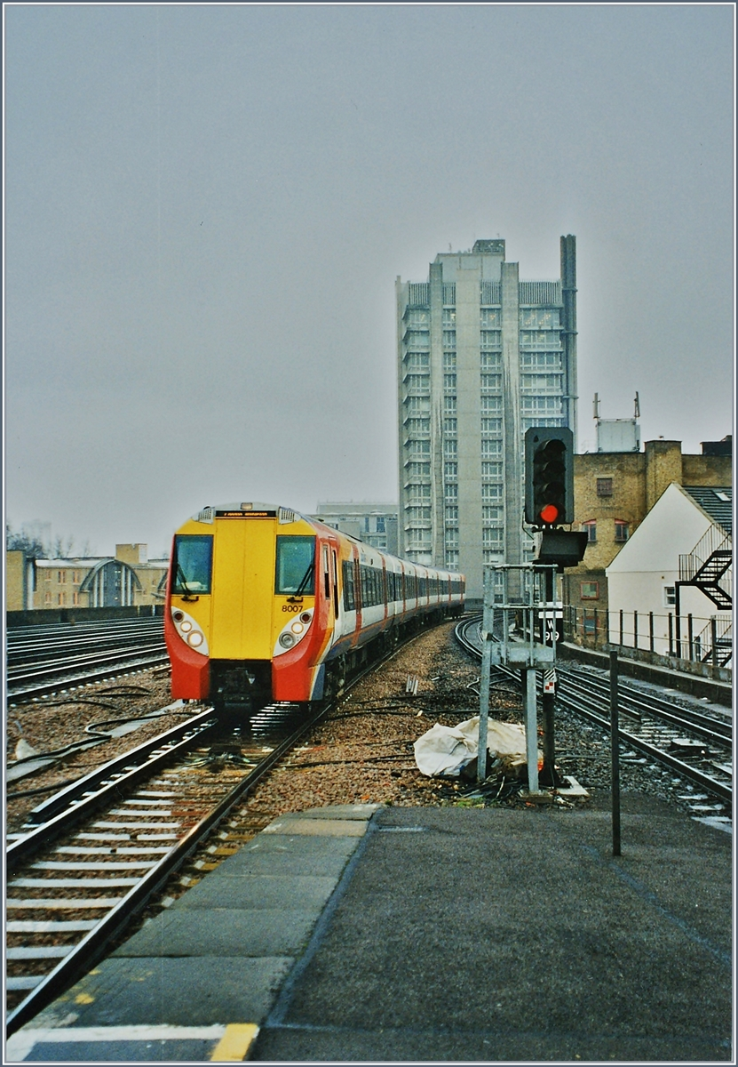 A old analog picture from a Class 458 South West Trains in Vauxhall.