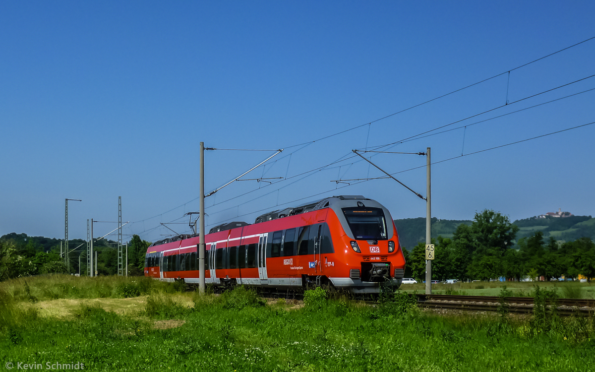 A regional express train with emu series 442 106, called 'Talent 2', is on the ride from Jena to Nuremberg near Kahla, Thuringia, with its famous 'Leuchtenburg' in the background. (19 June 2013)