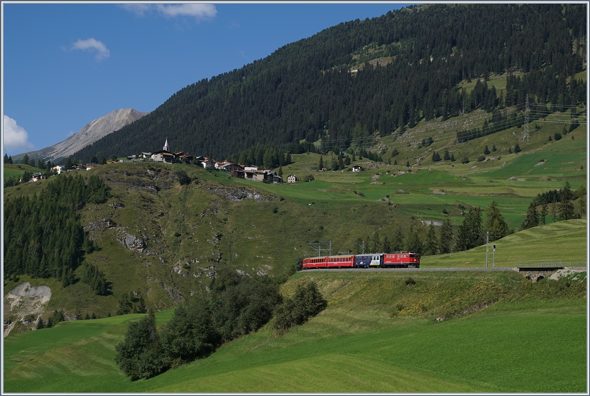 A RhB Ge 6/6 II with fast train from St Moritz to Chur near BErgün Bravuogn.