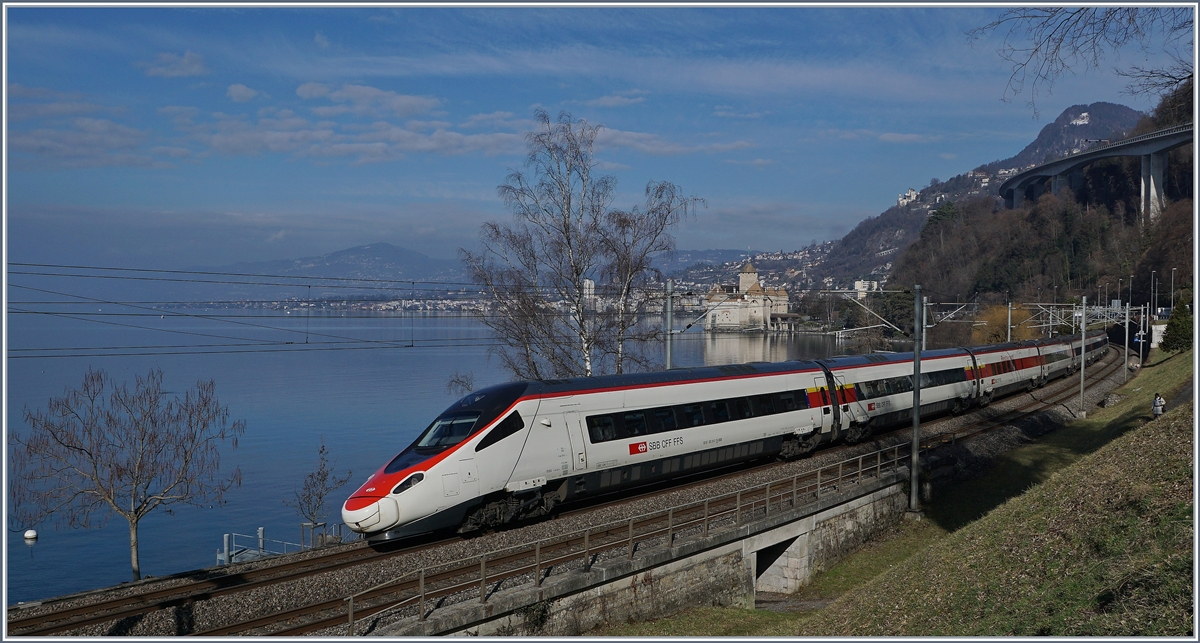 A SBB ETR 610 from Milano to Geneva by the Castle of Chillon.