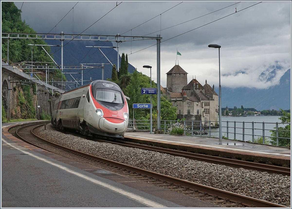 A SBB ETR 610 on the way to Geneva by the Castle of Chillon.