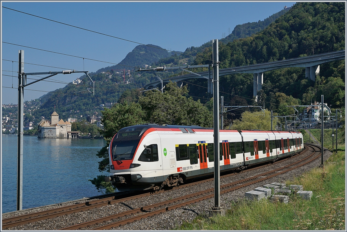 A SBB RABe 523 FLIRT on the way to Lausanne by the Castle of Chillon.