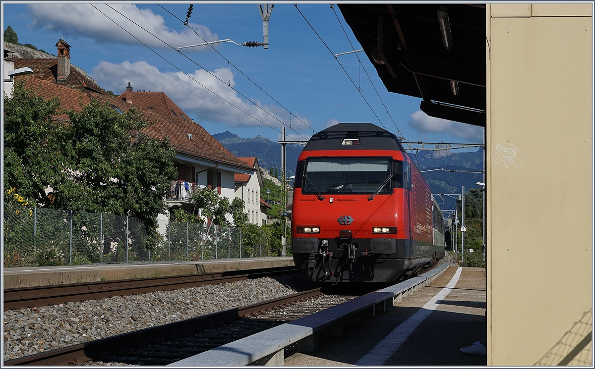 A SBB Re 460 with an IR in St Saphorin. 