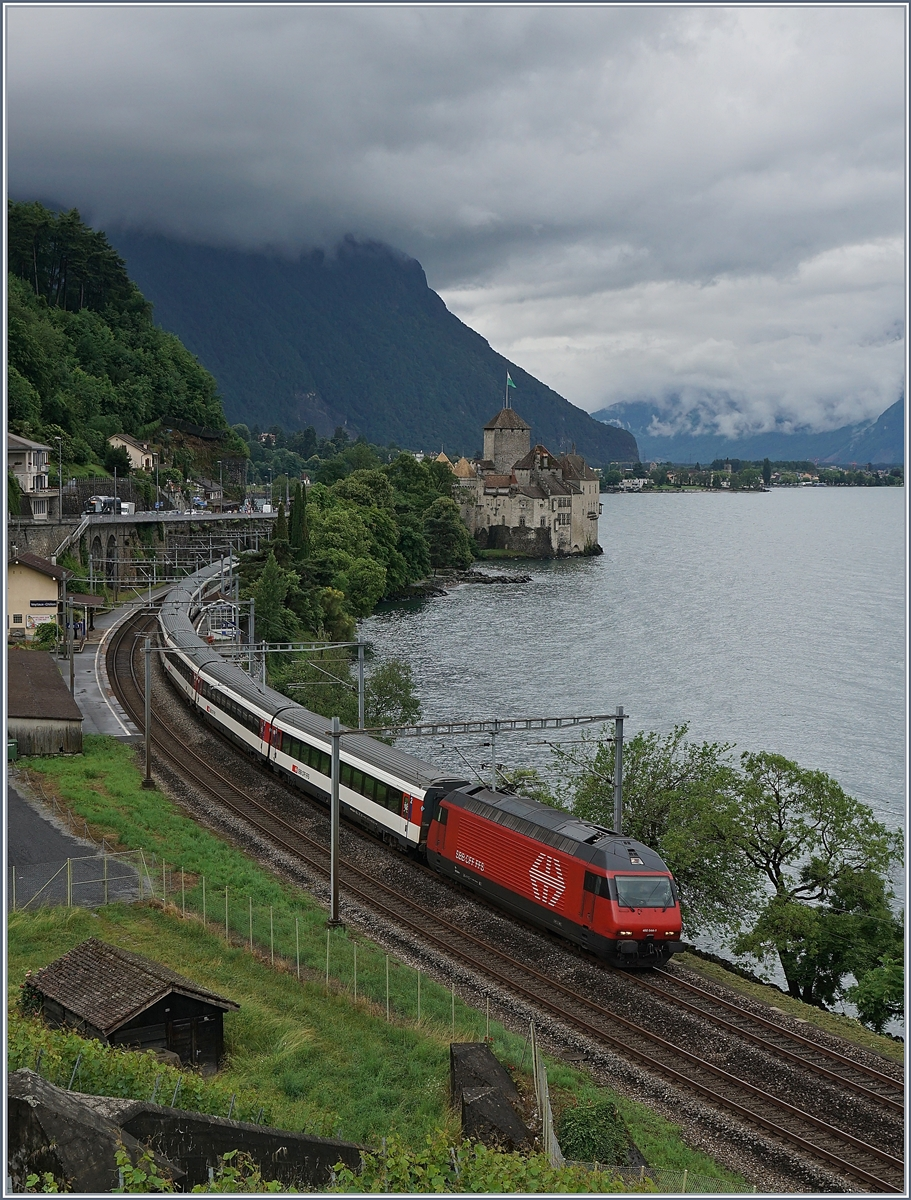 A SBB Re 460 with an IR to Geneva near the Castle of Chillon. 
