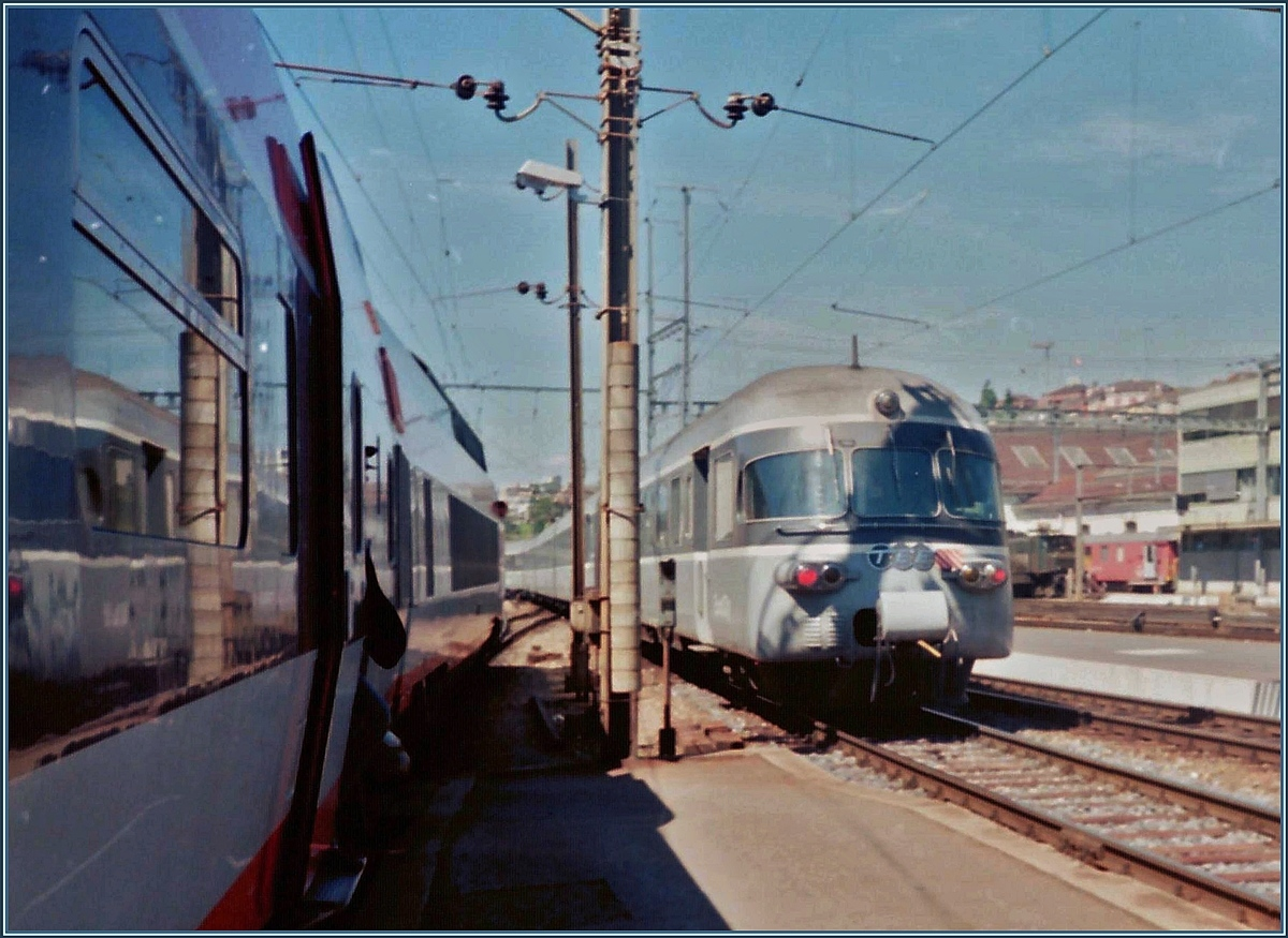 A SBB TEE RAe is a Eurocity from Milano to Geneve and is leaving Lausanne.