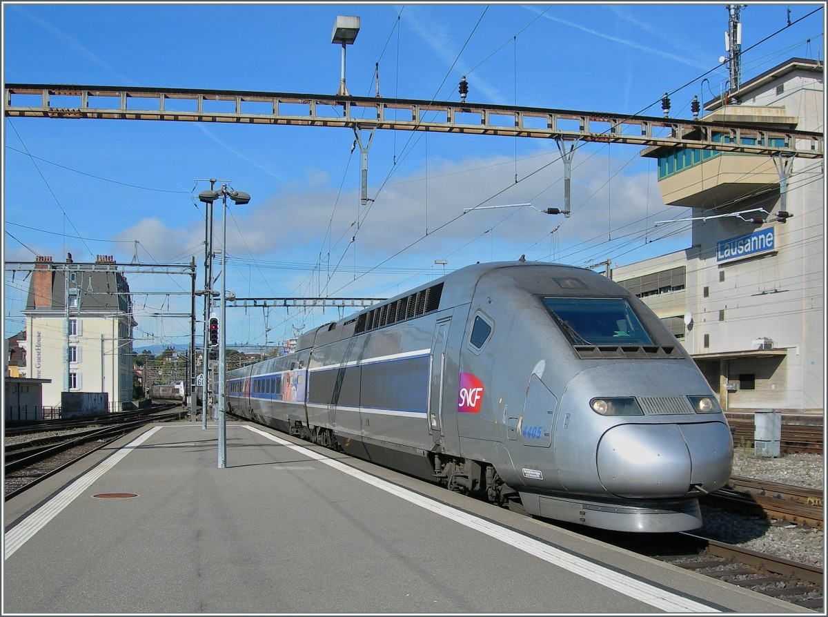 A TGV Lyria from Paris is arriving at  Lausanne.