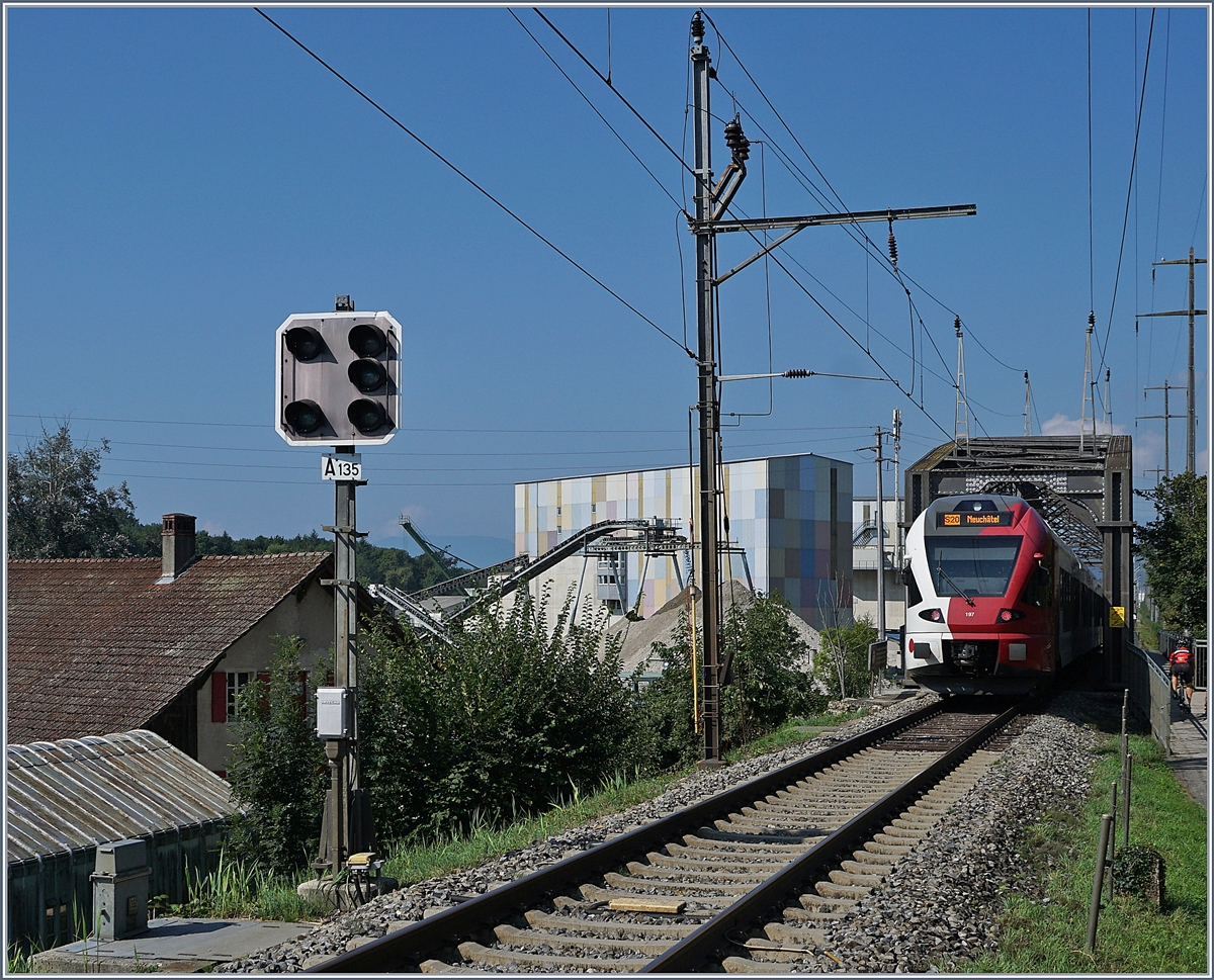 A TPF Flirt on the way to Neuchatel by the Station Ziehlbrücke. 