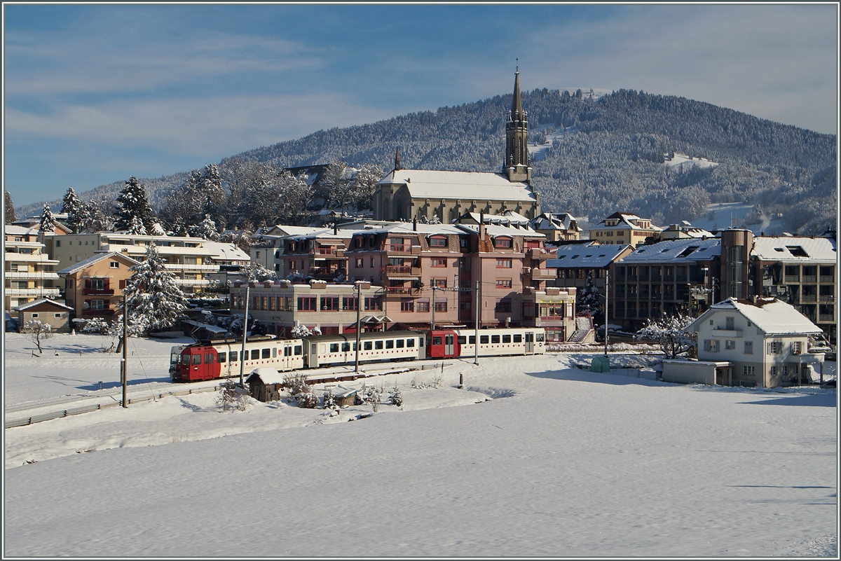 A TPF local train is leaving Chatel St Denis.