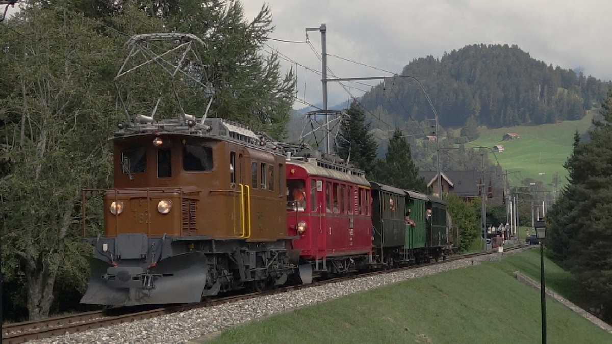 Bernina Krokodil RhB 182 and Bernina Triebwagen RhB 35 on the Montreux - Berner Oberland Bahn (MOB) near Rougement VD