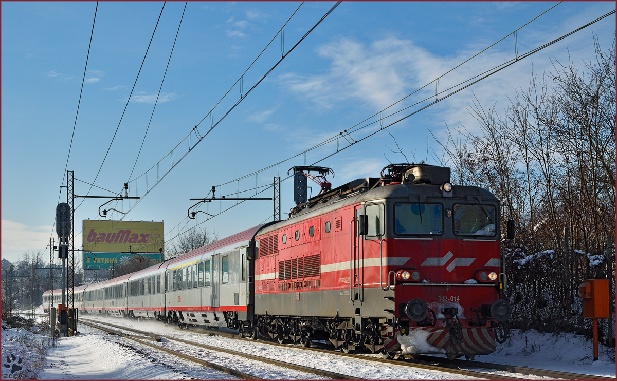 Electric loc 342-014 pull EC158 'Croatia' through Maribor-Tabor on the way to Vienna. /2.1.2015