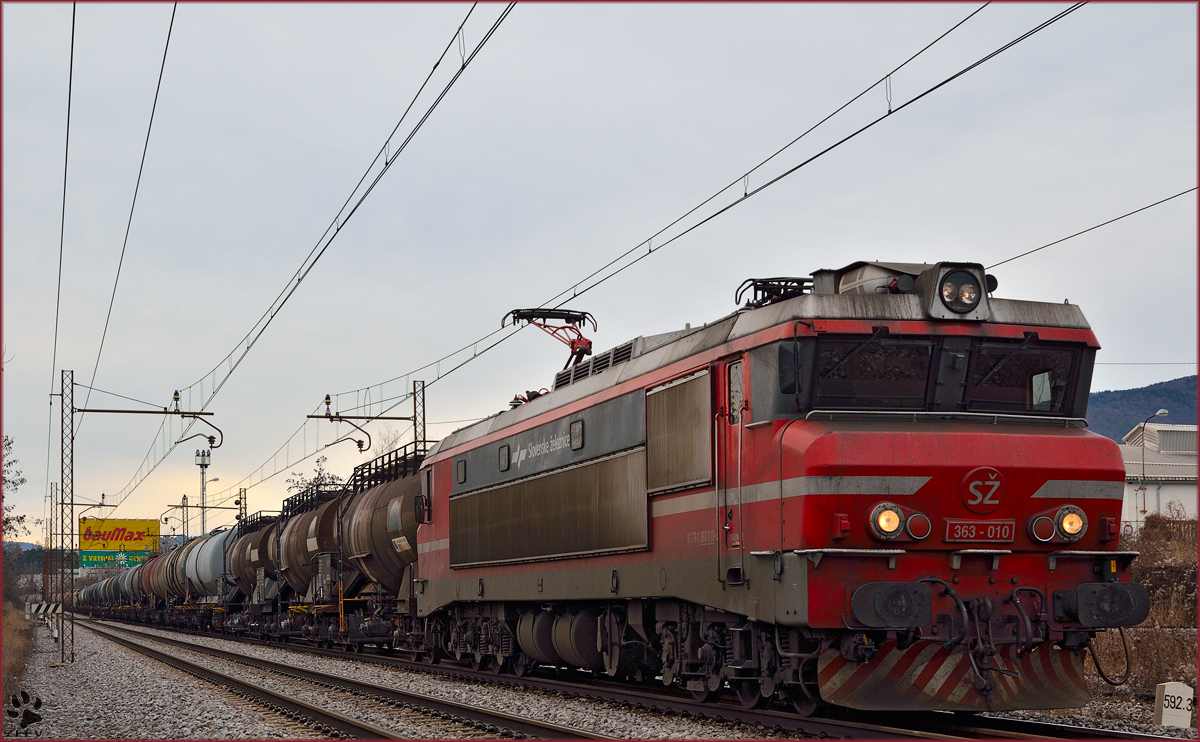 Electric loc 363-010 is hauling freight train through Maribor-Tabor on the way to the north. /7.1.2014