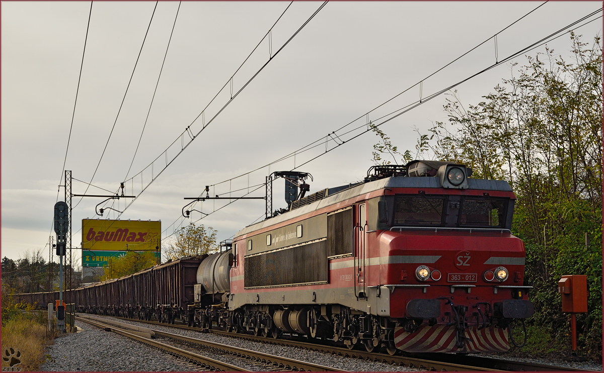 Electric loc 363-012 pull freight train through Maribor-Tabor on the way to the north. /11.11.2014