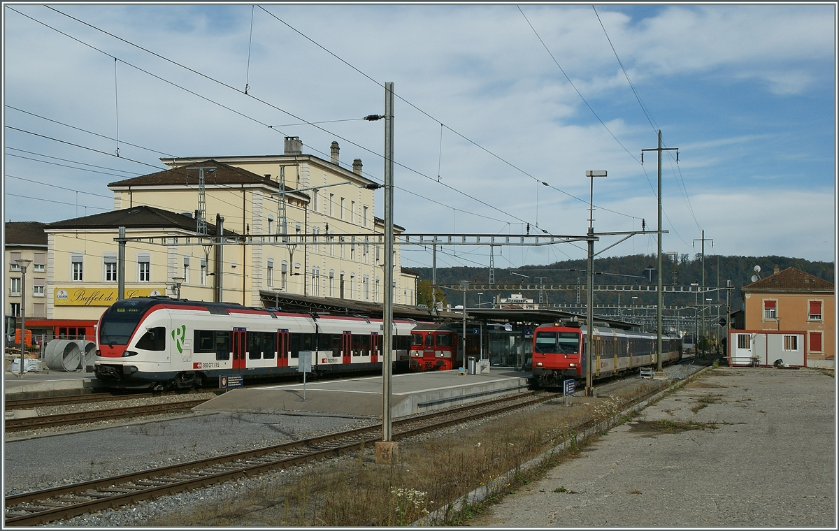 Local trains in Porrentruy: a Flit to Basel, The CJ BDe 4/4 to Bonfol and a NPZ to Biel/Bienne.