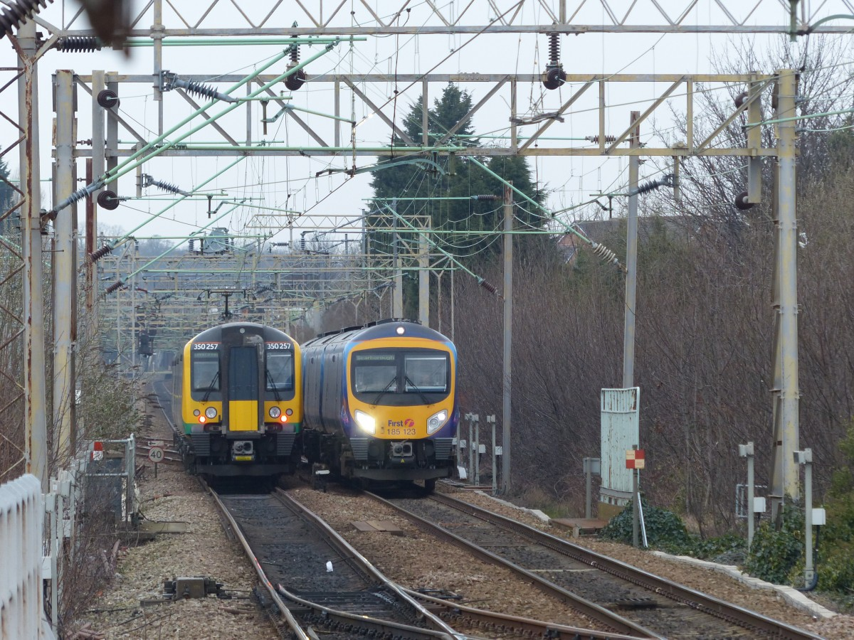 London Midland Class 350 257 and First TransPennine 185 123 meet in Liverpool South Parkway railway station, 11.3.2015