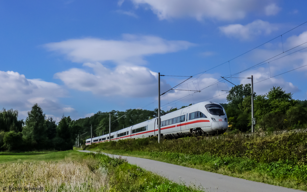 Long distance train ICE 1512 from Munich to Hamburg is on the ride through the Saale river valley near Kahla and will soon reach its next stop at Jena Paradies. (8 September 2012)