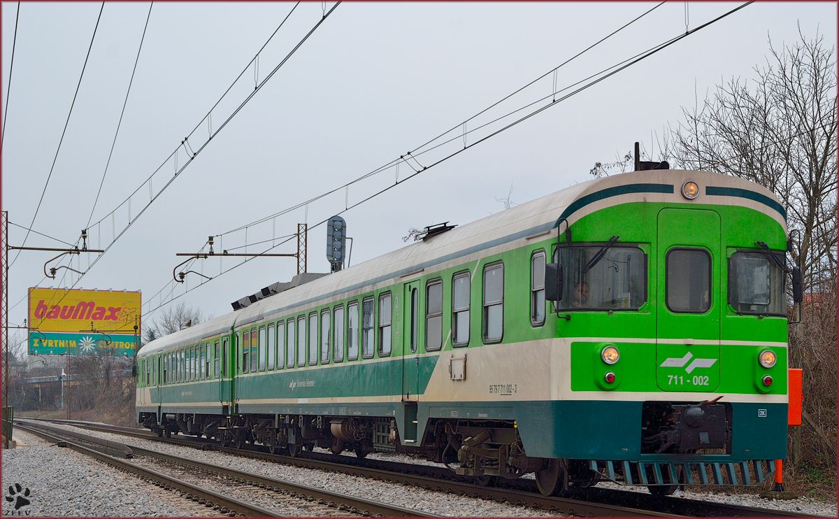 Multiple units 711-002 are running through Maribor-Tabor on the way to Maribor station. /3.3.2014