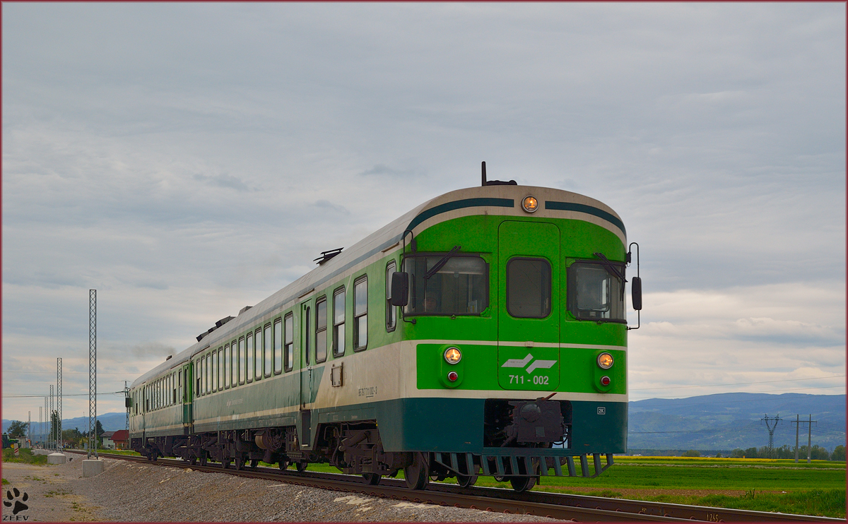 Multiple units 711-002 are running through Cirkovce on the way to Murska Sobota. /17.4.2014