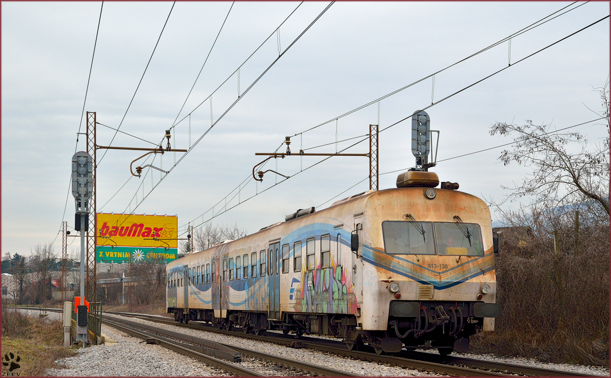Multiple units 813-130 are running through Maribor-Tabor on the way to Maribor station. /20.2.2014