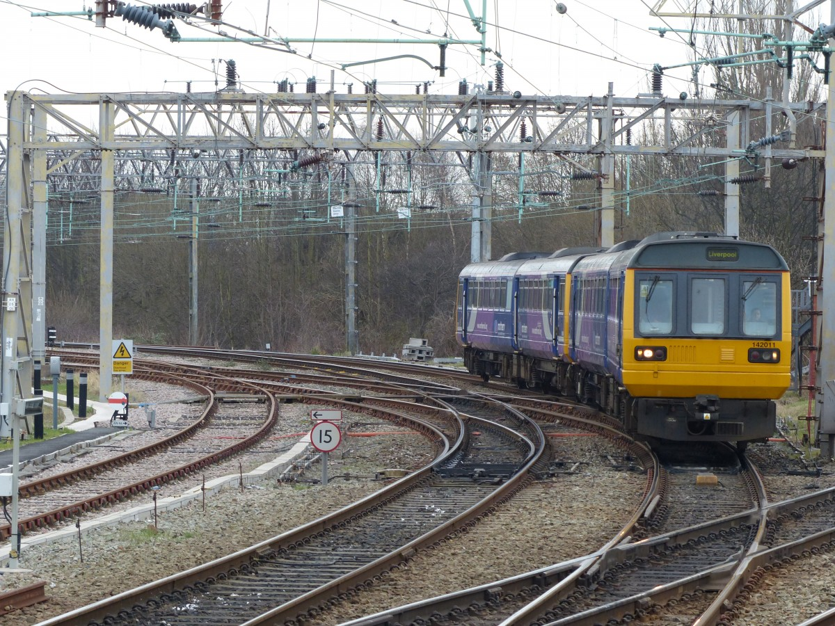 Northern DMU 142 011 arriving at Liverpool South Parkway Station, 11.3.2015