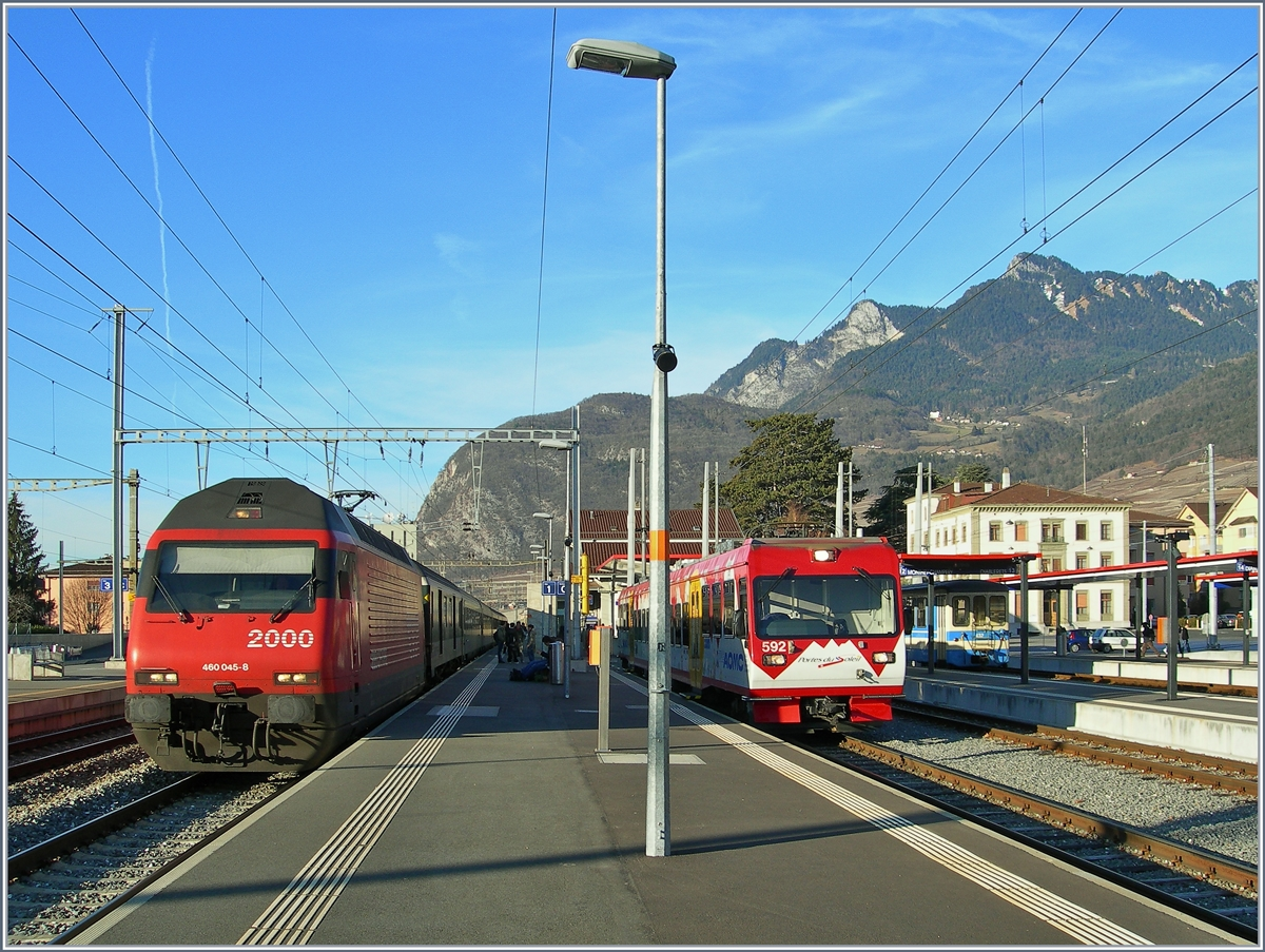 SBB Re 460 045-8 and TPC (AOMC) Bhe 4/8 592 in Aigle. 
