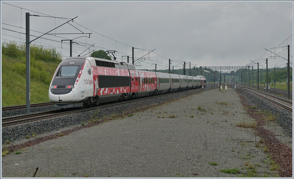 TGV Lyria 9203 from Paris to Zürich is leaving Belfort Montbéliard TGV. 