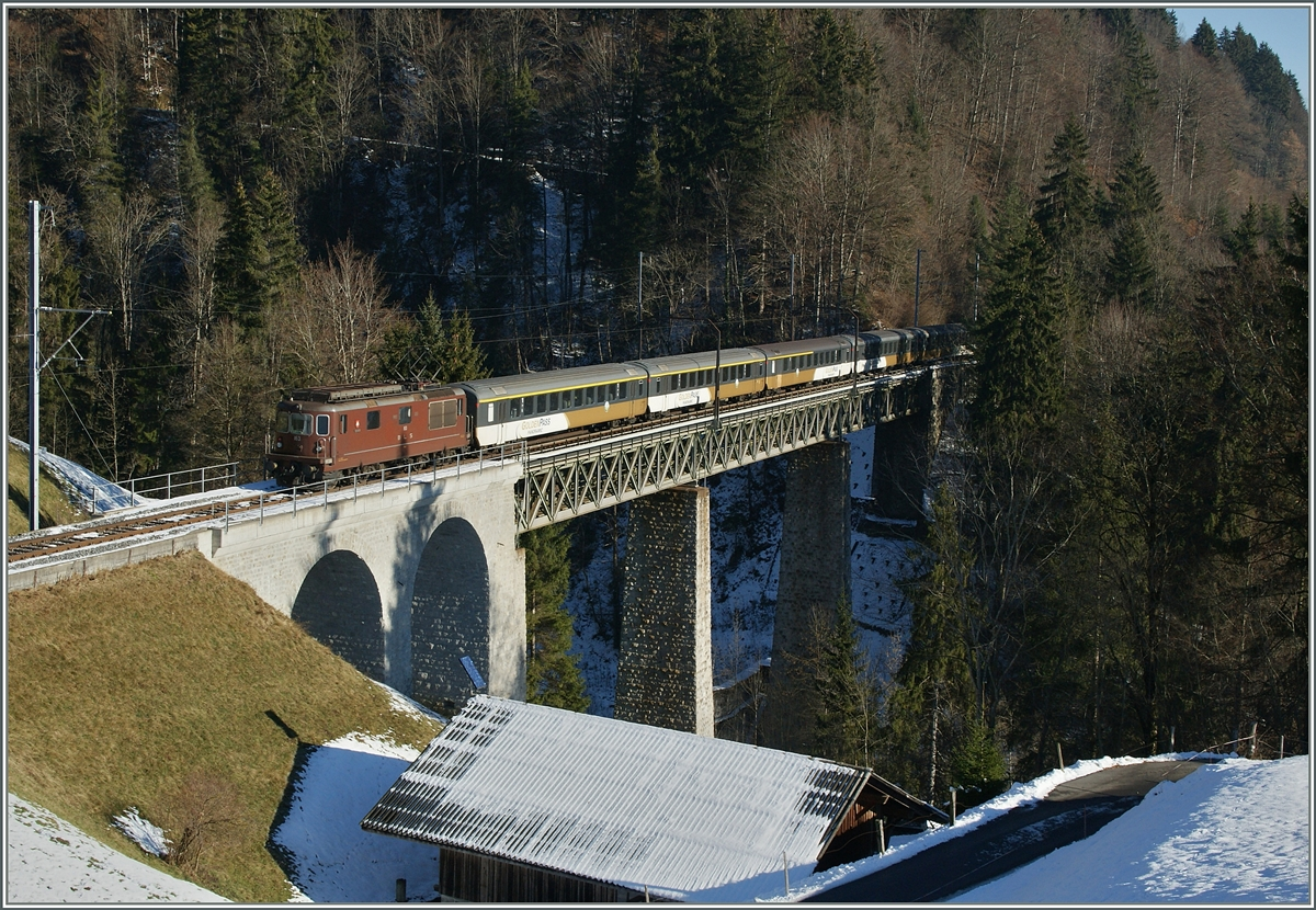 The BLS Re 4/4 193  Grenchen  with the BLS Goldenpass RE 3118 from (Montreux) - Zweisimmen - Interlaken - (Luzern) near Weissenburg.
