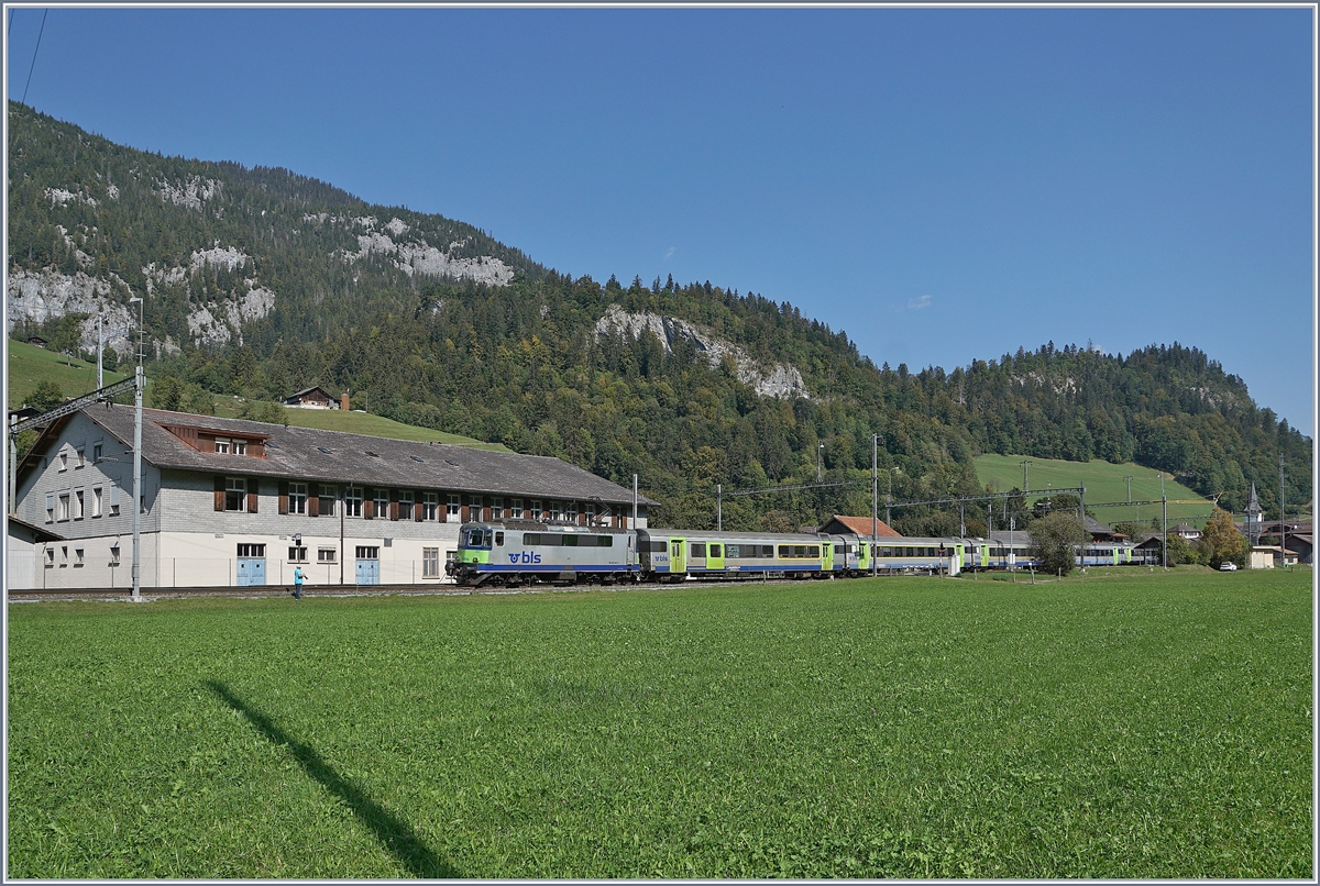 The BLS Re 4/4 II 501 with his RE from Interlaken Ost to Zweisimmen by Boltigen. 