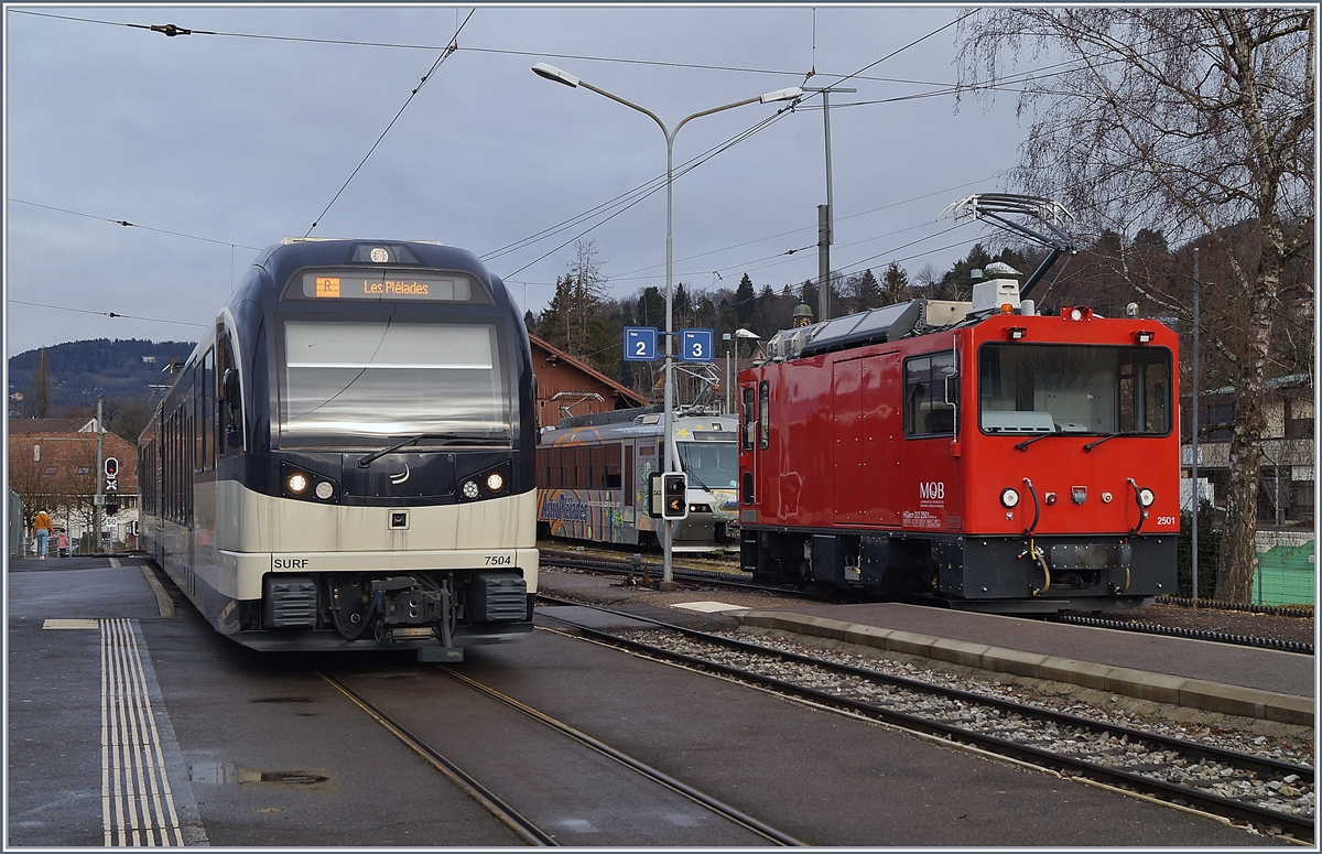 The CEV ABeh 2/6 7501 and the MOB HGem 2/2 2501 in Blonay.