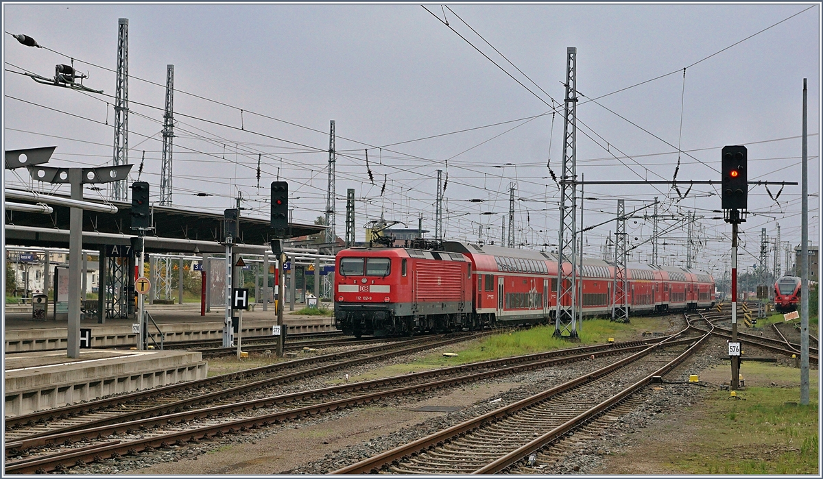 The DB 112 102-2 is leaving Rostock with a RE in direction of Berlin.