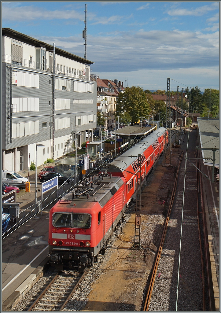 The DB 143 364-8 wiht a RB to Seebrugg in Freiburg i.B. 