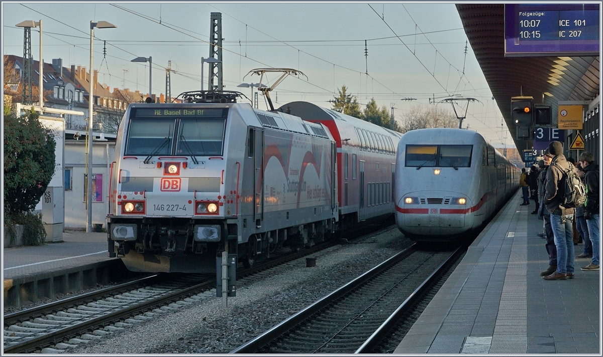 The DB 146 227-4 and a ICE in Freiburg i.B.