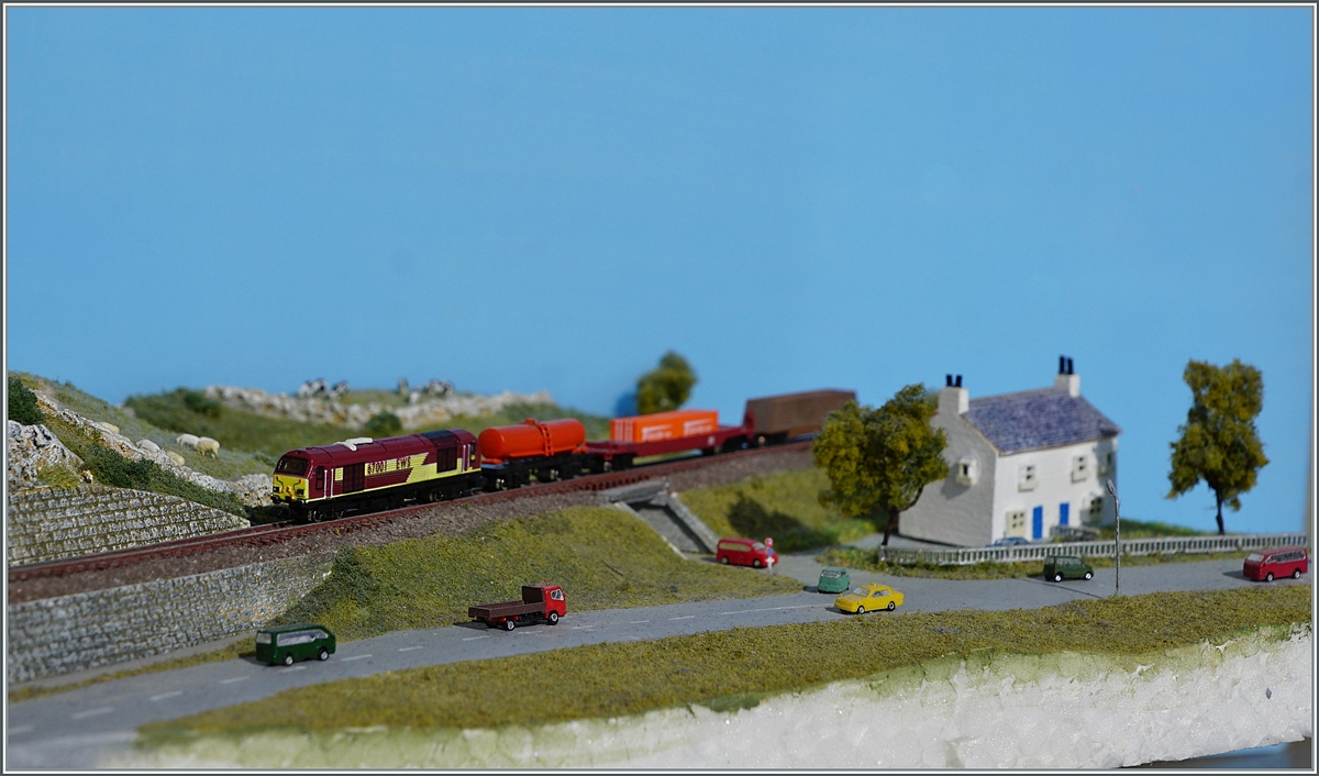 The EWS T Gauge 67001 with a Cargo train on my Diorama. 