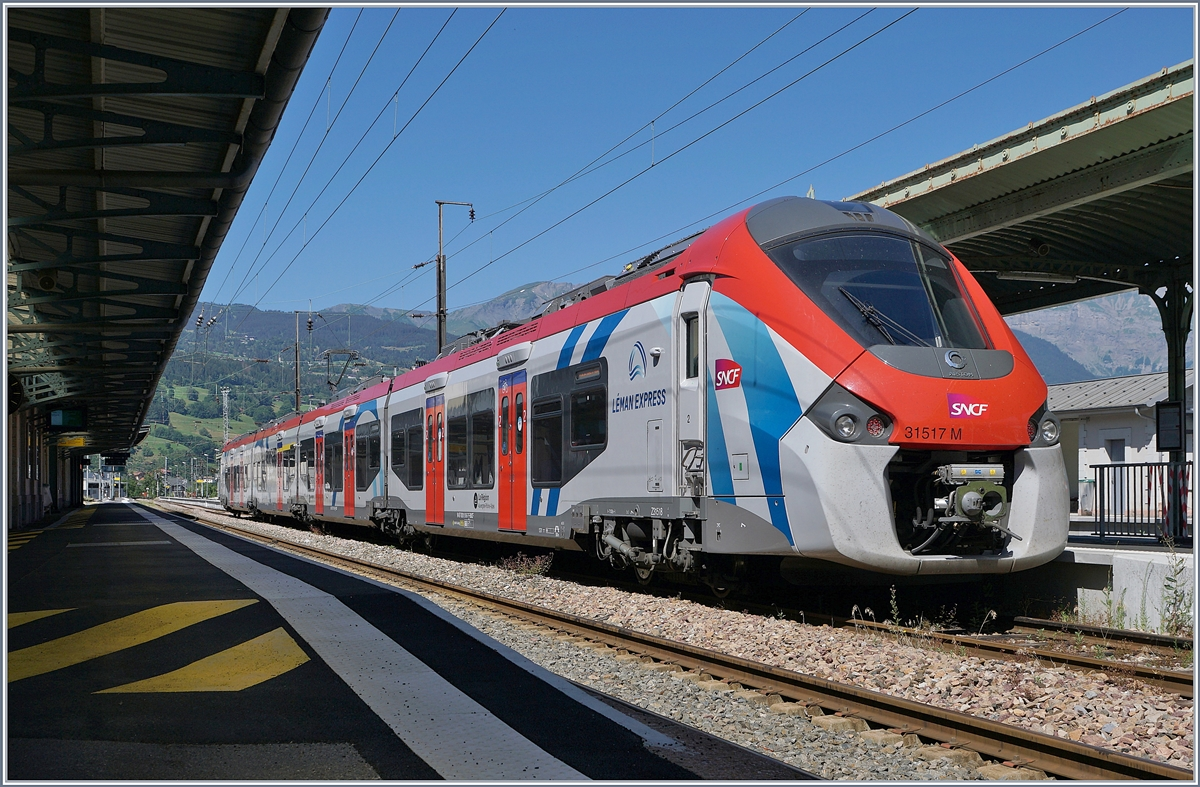 The Léman Express SNCF Z 31517 M in the St Gervais les Bains le Fayet Station will be the  L3 23482 to Coppet. 