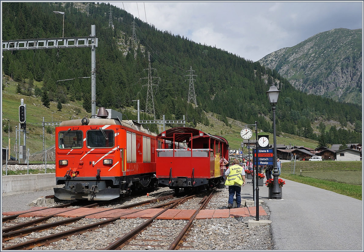 The MGB HGm 4/4 61 on a DFB-Service is arriving at Oberwald.