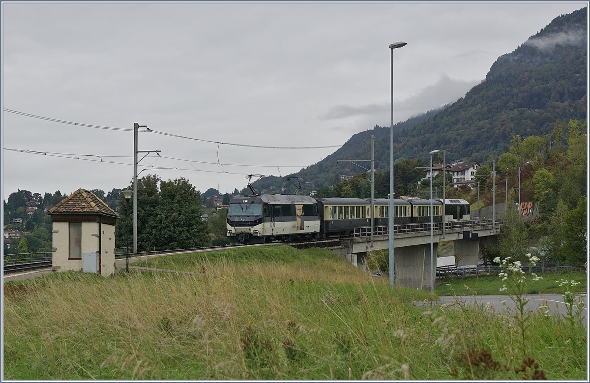 The MOB Ge 4/4 8001 with the MOB GoldenPass Belle Epoque service from Zweisimmen to Montreux by Châtelard VD. 