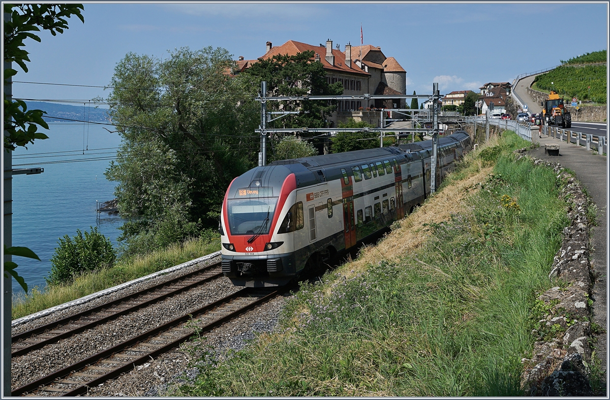 The SBB RABE 511 114 on the way to Vevey by Rivaz. 
