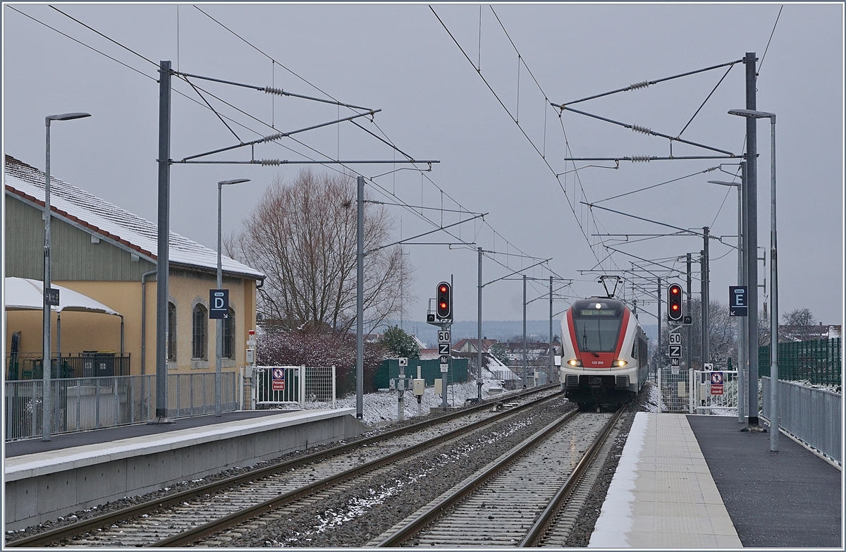 The SBB RABe 522 206 on the way from Meroux TGV to Biel/Bienne is arriving at the new Grandvillars Station.