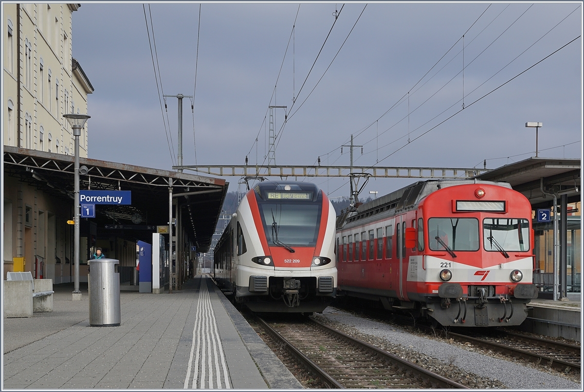 The SBB RABe 522 209 from Delle to Biel/Bierne and the BLS CJ RBDe 566 221 to Bonfol in the Porrentury Station.15.12.2018
