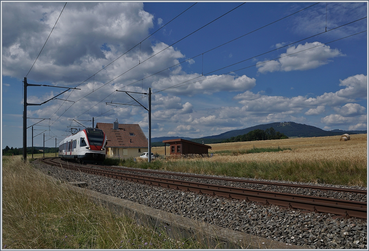 The SBB RABe 523 021  La Veveyse  on the way from Vallorbe to Villeneuve by Arnex. 