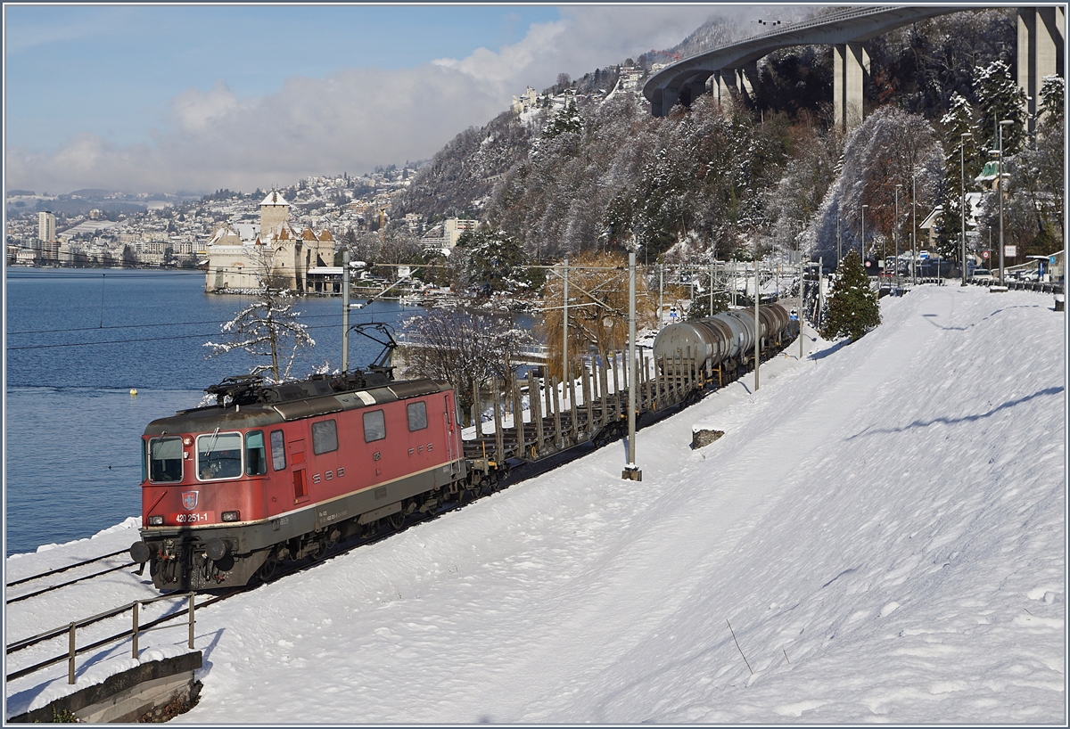 The SBB Re 420 251-1 with a Cargo train by the Castle of Chillon.