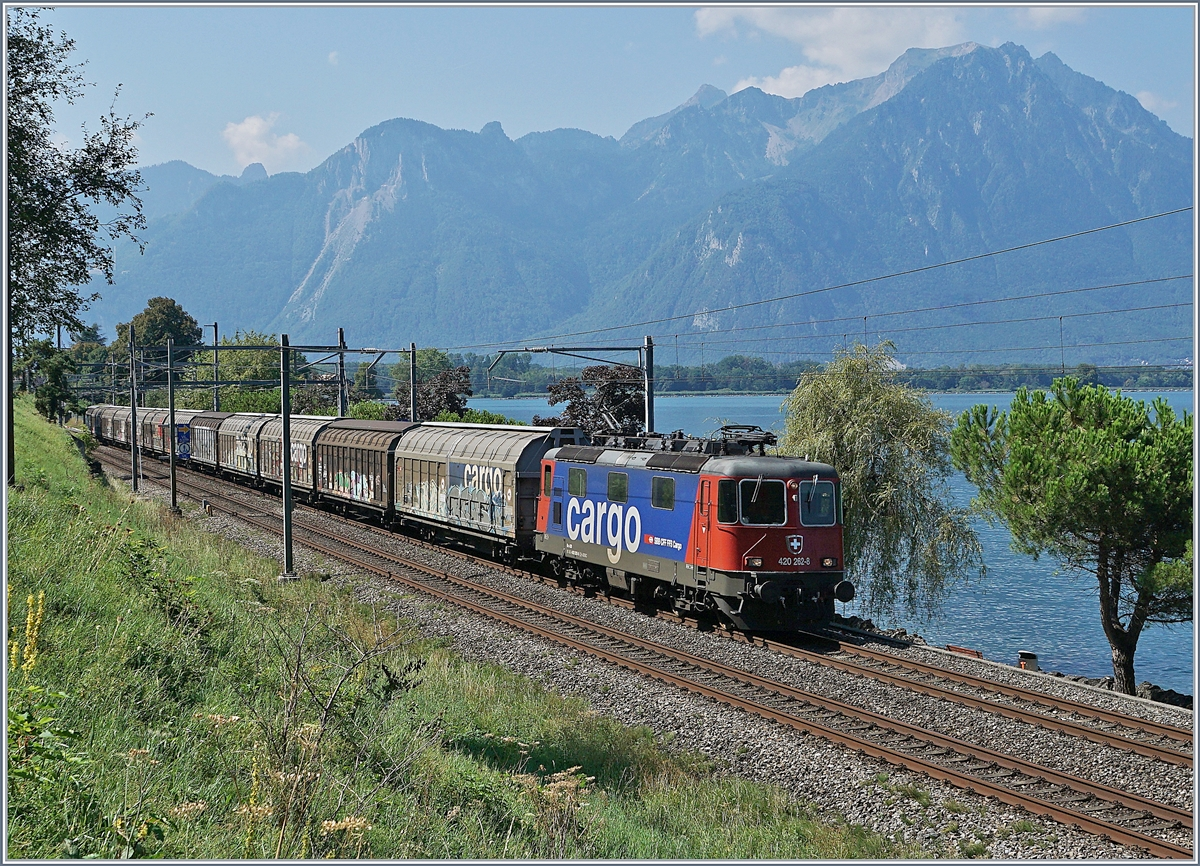 The SBB Re 420 262-5 with a Cargo train by Villeneuve.