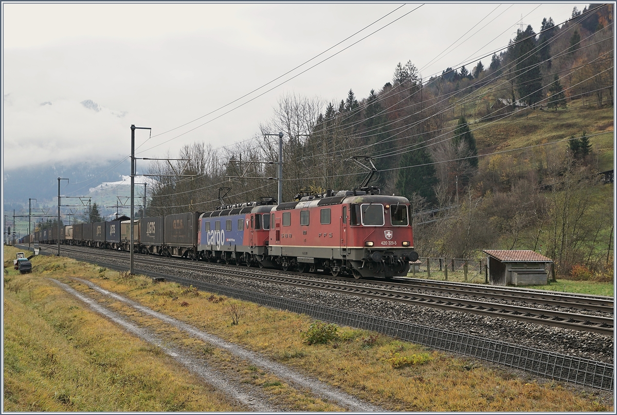The SBB Re 420 329-5 and a Re 620 wiht a Cargo Train by Mülenen.