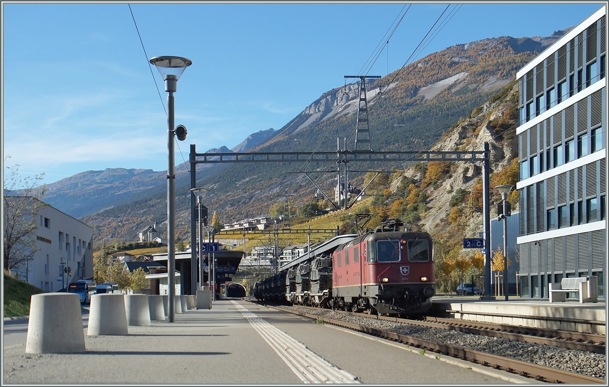 The SBB Re 4/4 11358 wiht a military cargo train in Leuk.