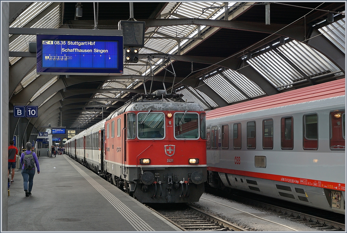 The SBB Re 4/4 II 11134 with an IC to Stuttgart in Zuerich Main Station.