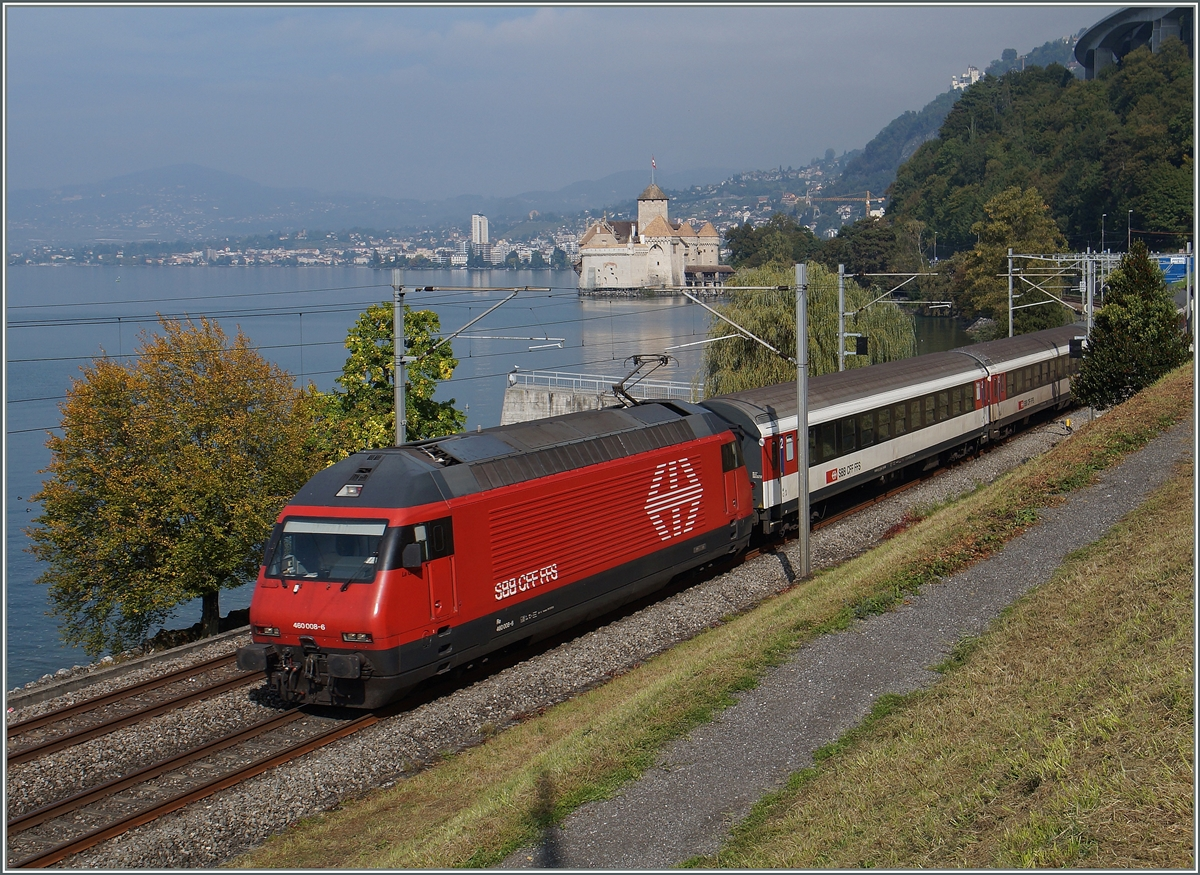 The SBB RE 460 008-6 wit an IR to Brig by the Chastle of Chillon.